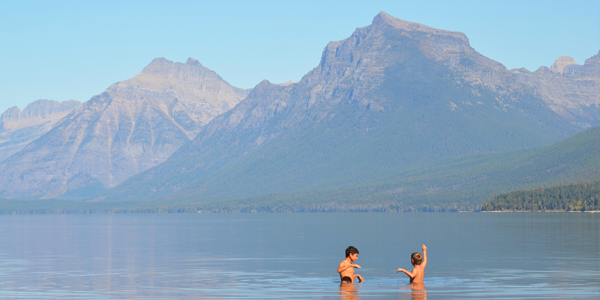 The boys take a swim in Mc Donald Lake at Glacier National Park